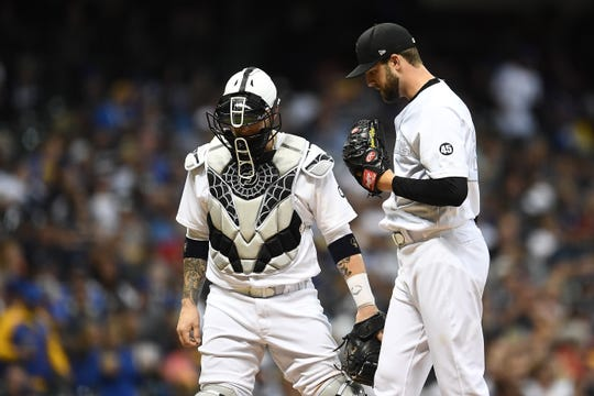 Brewers catcher Yasmani Grandal and starter Jordan Lyles were among nine Brewers to exercise their rights to free agency.
