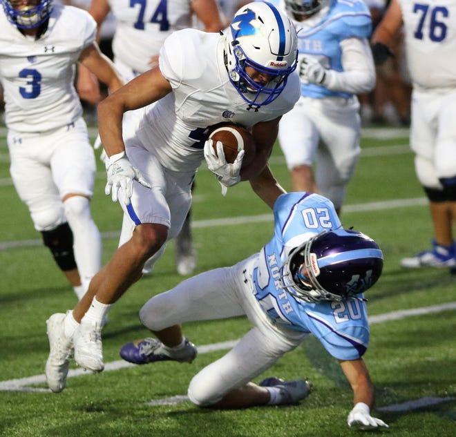 Mukwonago running back Cole Kaestner rushes through the Waukesha North defense on Friday night at Waukesha North High School.