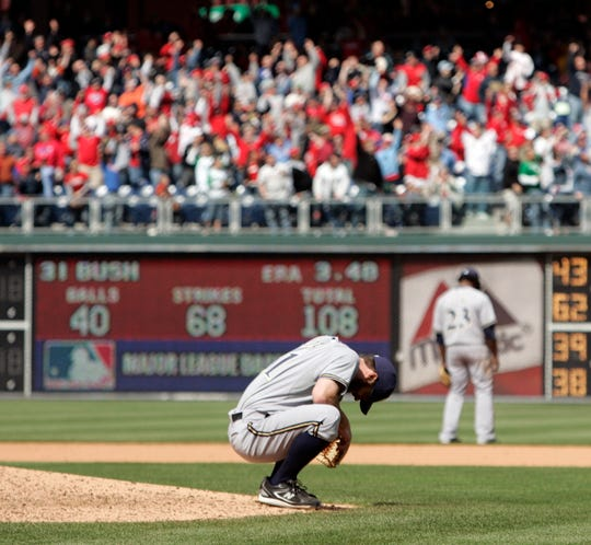 Brewers starting pitcher Dave Bush reacts after Philadelphia Phillies pinch-hitter Matt Stairs hit a solo home run breaking up his no-hitter in the eighth inning of a baseball game Thursday, April 23, 2009, in Philadelphia. The Brewers won 6-1.