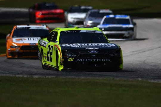 Austin Cindric leads a pack of cars Saturday during the CTech Manufacturing 180 at Road America.