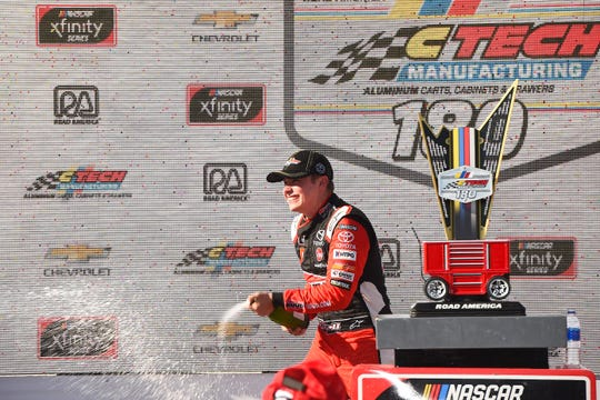 Christopher Bell celebrates his victory in the  NASCAR Xfinity Series CTech Manufacturing 180 Saturday at Road America.