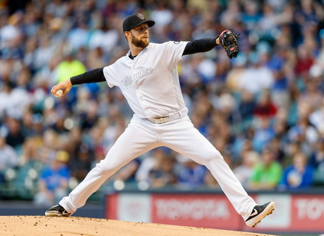 Brewers pitcher Jordan Lyles throws a pitch during the first inning.