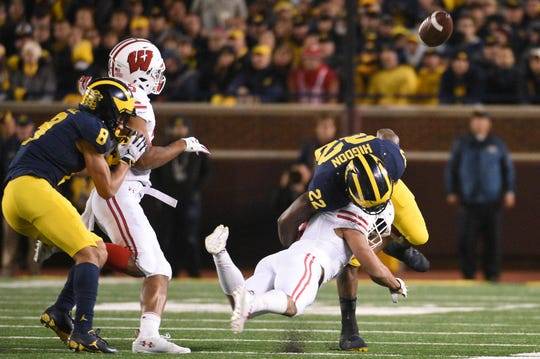 UW safety Reggie Pearson hits Michigan running back Karan Higdon and forces a fumble during a game Oct 13, 2018, in Ann Arbor, Michigan.