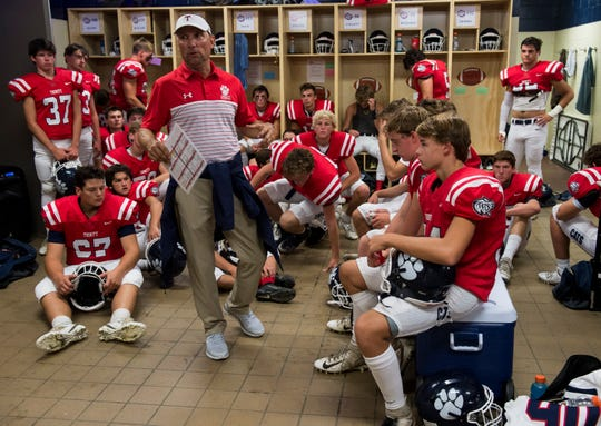 Trinity head coach Barry Loyal talks with his players in the locker room at Trinity Presbyterian High School in Montgomery, Ala., on Friday, Aug. 23, 2019. Alabama Christian leads Trinity 13-0 at halftime.