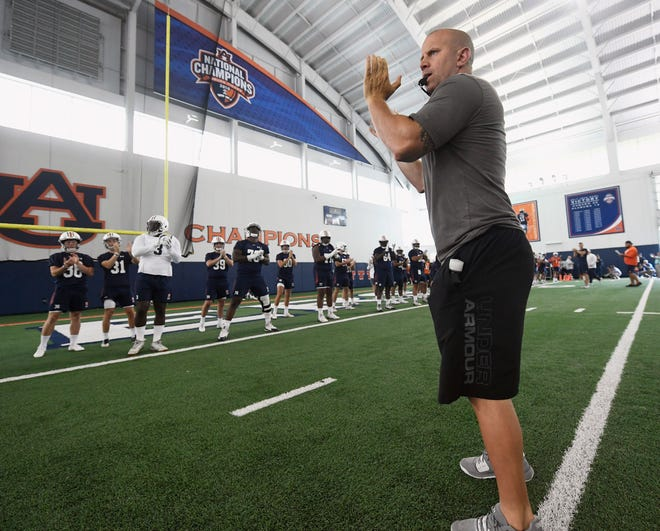 Auburn strength and conditioning coach Ryan Russell leads players through stretch during practice on Friday, Aug. 2, 2019 in Auburn, Ala.