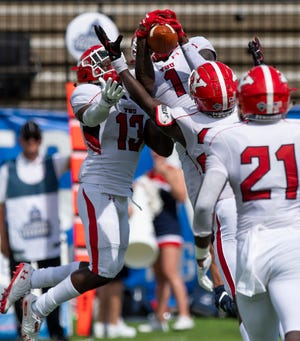Youngstown defensive back Zaire Jones (1) snags an interception against Samford during the Guardian Credit Union FCS Kickoff at Cramton Bowl in Montgomery, Ala., on Friday August 23, 2019.