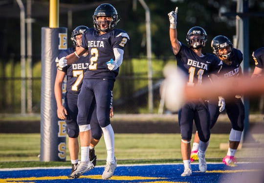 Delta's Wesley Stitt celebrates a touchdown against Central during their game at Delta High School Saturday, Aug. 23, 2019.