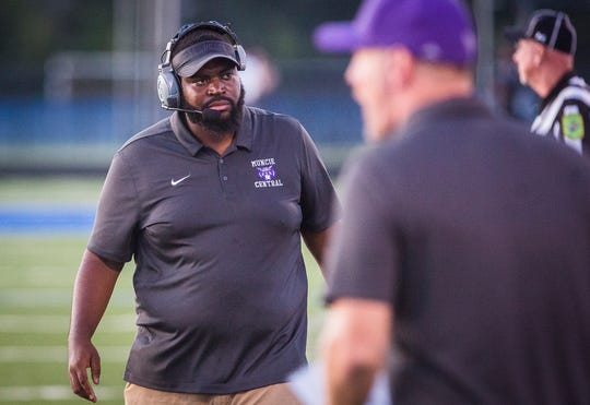 FILE -- Muncie Central coach Darrick Lee coaches in the Bearcats' game against the Delta Eagles on Aug. 23, 2019. Central lost against Anderson on Sept. 6, 2019.
