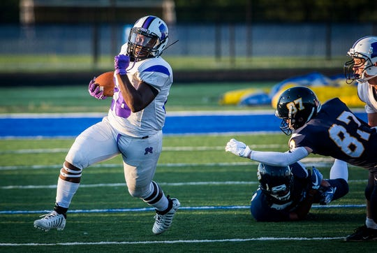FILE -- Muncie Central running back Shoka Griffin slips away from Delta's defense during the Bearcats' game against the Eagles on Aug. 23, 2019. Griffin rushed for two touchdowns against Anderson on Sept. 6, 2019.