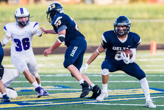 Delta's Wesley Stitt finds an opening in Central's defense during their game at Delta High School Saturday, Aug. 23, 2019.