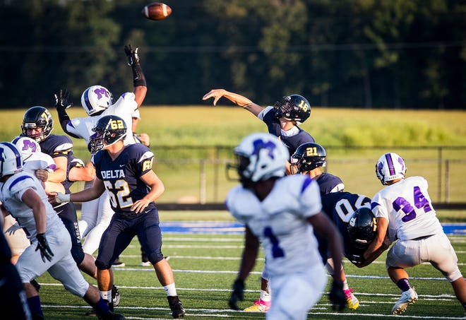 FILE -- Delta quarterback Brady Hunt attempts a pass during the Eagles' win against Muncie Central in each school's 2019 season opener. Hunt led the Eagles to another victory Friday against Eastbrook.