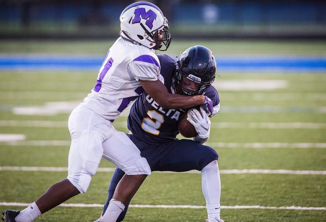 FILE -- Muncie Central's Da'Marion Walker makes a tackle during Central's games against Delta at Delta High School Saturday, Aug. 23, 2019.