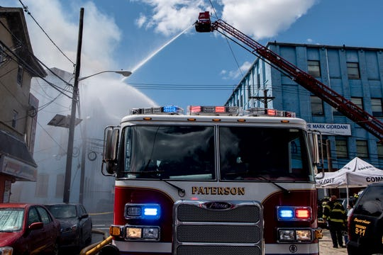 A Paterson fire truck at the scene of a five alarm fire at 410 Straight Street in Paterson on Saturday August 24, 2019.