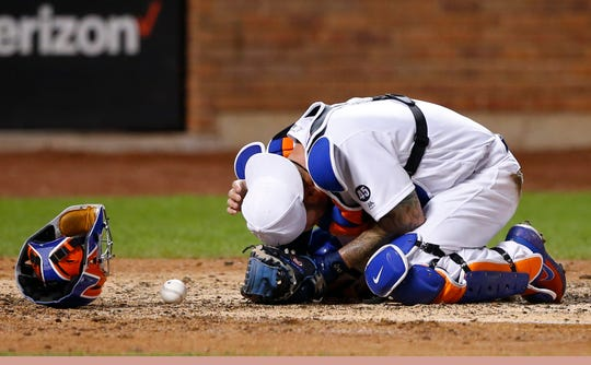 Aug 23, 2019; New York City, NY, USA;  New York Mets catcher Tomas Nido (3) grabs his head after being hit by the bat of Atlanta Braves third baseman Josh Donaldson (20) in the sixth inning  in the sixth inning during an MLB Players' Weekend game at Citi Field.