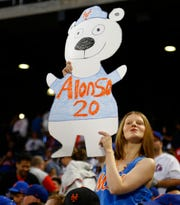 Mets fan with a Pete Alonso sign in this file photo