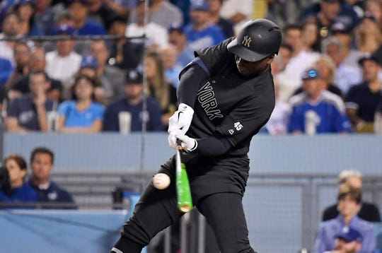 New York Yankees' Didi Gregorius hits a grand slam during the fifth inning of the team's game against the Los Angeles Dodgers on Friday, Aug. 23, 2019, in Los Angeles on MLB Players' Weekend.