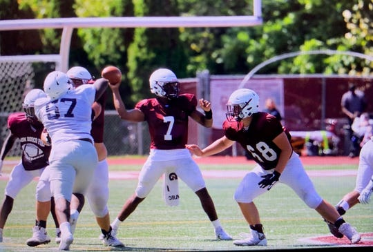 Don Bosco quarterback Jahquil Batts (7) accounted for two scores in the Ironmen's scrimmage against Mater Dei Prep.