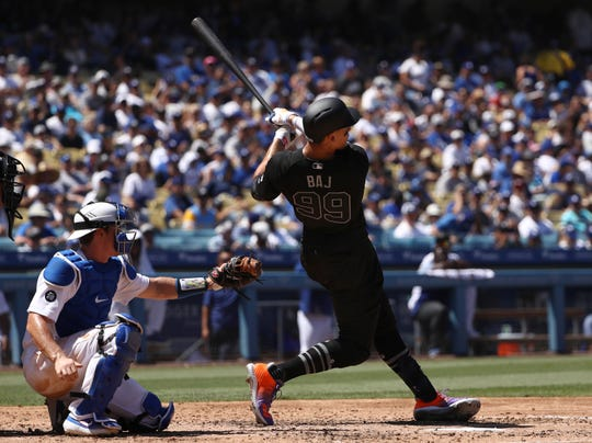 Aaron Judge #99 of the New York Yankees hits a solo home run during the fourth inning of the MLB game against the Los Angeles Dodgers at Dodger Stadium on August 24, 2019 in Los Angeles, California. Teams are wearing special color-schemed uniforms with players choosing nicknames to display for Players' Weekend.
