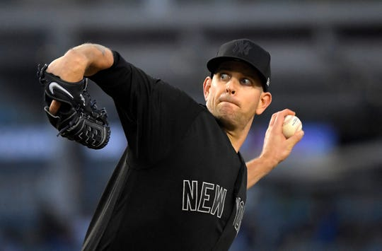 New York Yankees starting pitcher James Paxton throws during the first inning of a game against the Los Angeles Dodgers on Friday, Aug. 23, 2019, in Los Angeles on MLB Players Weekend.