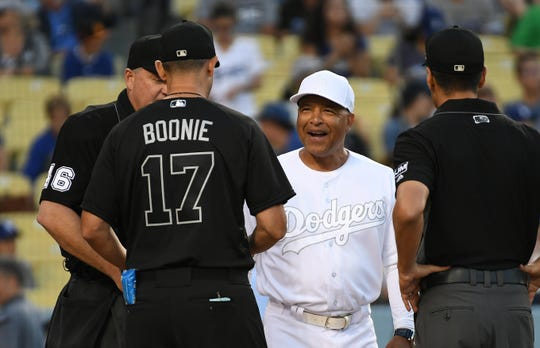 Aug 23, 2019; Los Angeles, CA, USA; Los Angeles Dodgers manager Dave Roberts (30) and New York Yankees manager Aaron Boone (17) meet before the game during an MLB Players' Weekend game at Dodger Stadium.