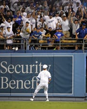 Los Angeles Dodgers right fielder Cody Bellinger watches a ball hit by New York Yankees' Didi Gregorius go out for a grand slam during the fifth inning of a game Friday, Aug. 23, 2019, in Los Angeles on MLB Players' Weekend.