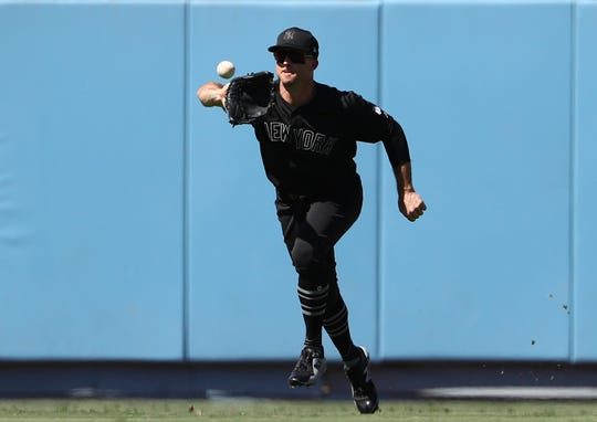 LOS ANGELES, CALIFORNIA - AUGUST 24: Brett Gardner #11 of the New York Yankees gets under a line drive to center for the catch during the sixth inning of the MLB game against the Los Angeles Dodgers at Dodger Stadium on August 24, 2019 in Los Angeles, California. Teams are wearing special color-schemed uniforms with players choosing nicknames to display for Players' Weekend.