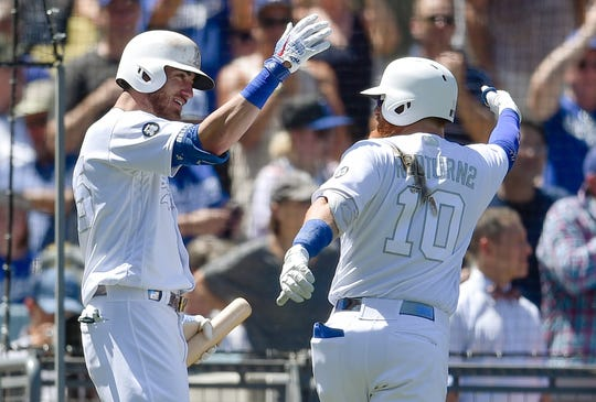 Los Angeles Dodgers' Justin Turner, right, celebrates with Cody Bellinger after hitting a two-run home run during the third inning of an MLB baseball game against the New York Yankees in Los Angeles, Saturday, Aug. 24, 2019 on MLB Players' Weekend.