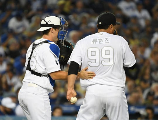 Aug 23, 2019; Los Angeles, CA, USA; Los Angeles Dodgers catcher Will Smith (16) and starting pitcher Hyun-Jin Ryu (99) meet during the second inning against the New York Yankees during an MLB Players' Weekend game at Dodger Stadium.