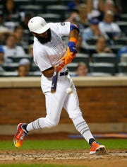 Aug 23, 2019; New York City, NY, USA; New York Mets shortstop Amed Rosario (1) breaks his bat in the third inning against the Atlanta Braves during an MLB Players' Weekend game at Citi Field.