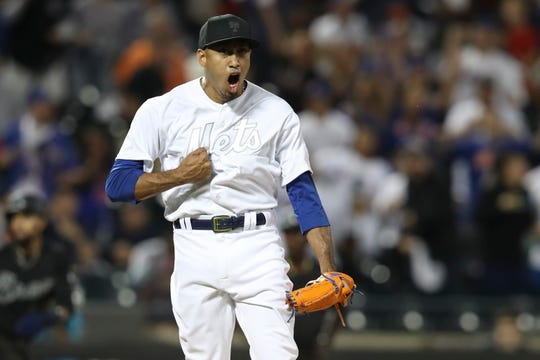 New York Mets relief pitcher Edwin Diaz reacts after striking out Atlanta Braves' Ozzie Albies during the 10th inning of a  game Friday, Aug. 23, 2019, in New York during MLB Players' Weekend.