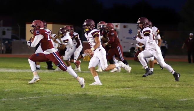 Senior Wildcat running back Ceazer Chavez , left, beats the Gadsden defense on a 37-yard touchdown run in the fourth quarter. Chavez scored three rushing touchdowns in Deming High's 26-19 win over the Panthers.