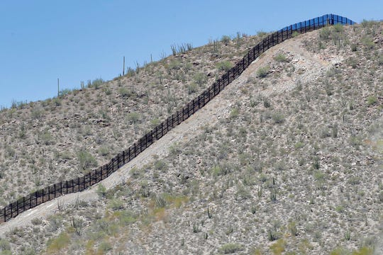 A rugged uphill section of the international border wall that runs through Organ Pipe National Monument is shown, Thursday, Aug. 22, 2019 in Lukeville, Ariz. Construction on a two-mile portion of replacement fencing funded by President Trump's national emergency declaration has begun in an area near the official border crossing that runs through Organ Pipe.