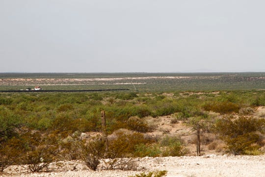 A crane can be seen at the beginning of new border wall construction about 20 miles west of Santa Teresa on Friday, Aug. 23, 2019. The wall visible on the left was built in 2018 with money allocated by Congress, while the new construction is funded by money reallocated from Department of Defense funding.