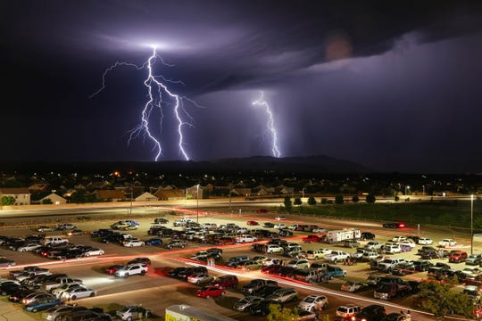 Many at the Field of Dreams leave the Mayfield vs. Atrisco Heritage Academy football game due to lighting in the area in Las Cruces on Friday, Aug. 23, 2019.