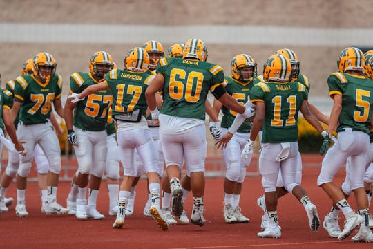 The Mayfield Trojans and the Atrisco Heritage Academy Jaguars prepare for the first game of the season at the Field of Dreams in Las Cruces on Friday, Aug. 23, 2019.