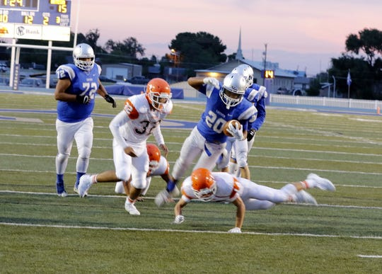 Carlsbad's Nate Najar is tackled near the goal line in the second quarter during the Eddy County War game on Aug. 23, 2019. Carlsbad won, 48-35.