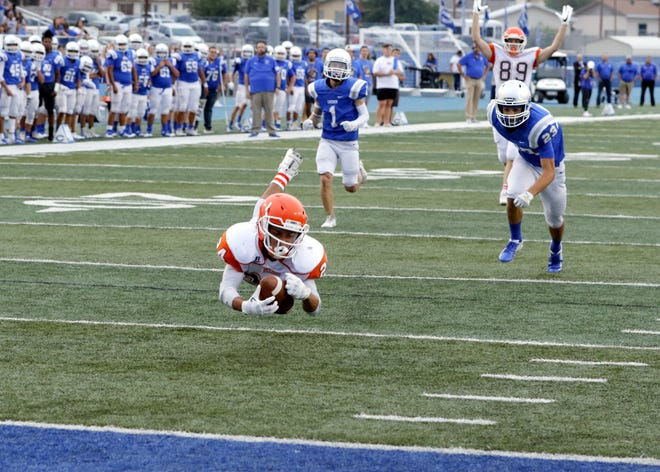 Artesia's Jacob Barrera makes a diving catch at the one-yard line during the Eddy County War game on Aug. 23, 2019. Barrera has scored six total touchdowns for the Bulldogs in their first four games.