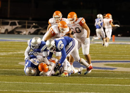 Carlsbad's defense sacks Artesia's Clay Houghtaling during the Eddy County War game on Aug. 23, 2019. Carlsbad won, 48-35.