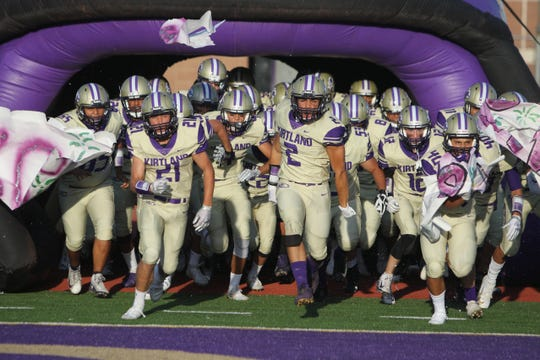 Kirtland Central storms out onto the field during pregame introductions in Friday's season opener at Bill Cawood Field in Kirtland.