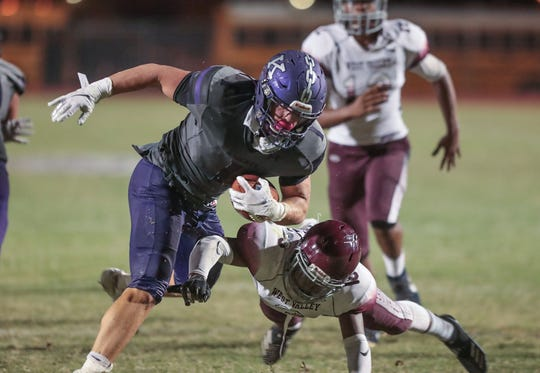 Jaden Donovan of Shadow Hills spins out of a tackle for a touchdown against West Valley, August 23, 2019.