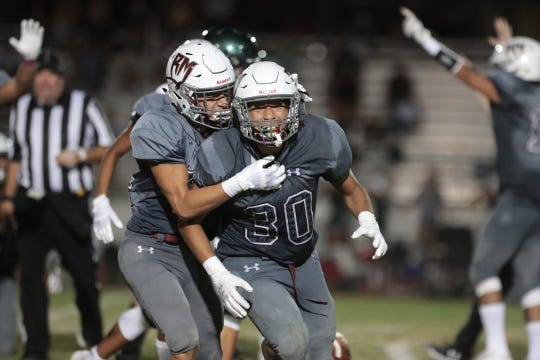 Rancho Mirage's Richard Hernandez, left, celebrates with Izrael Ramirez after he recovered a forced fumble by Twentynine High during the game in Rancho Mirage, Calif., on Friday, August 23, 2019.