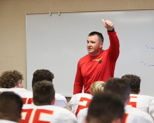Palm Desert head coach Shane McComb speaks to his team in the locker room on the opening night of the football season Aug. 23, 2019.