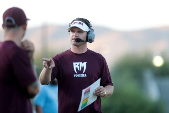 Rancho Mirage's head coach L.D. Matthews talks on the sidelines of the game against Twentynine Palms in Rancho Mirage, Calif., on Friday, August 23, 2019.