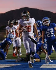 Simon Gaete finishes off a 9-yard run for Palm Desert's first touchdown against Beaumont on Friday, Aug. 23, 2019.