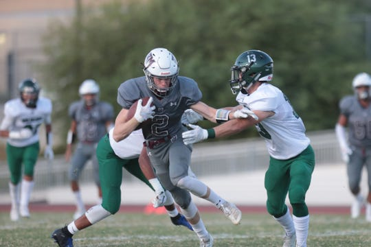 Rancho Mirage's Ty Hershberger breaks a tackle during the game against Twentynine Palms in Rancho Mirage, Calif., on Friday, August 23, 2019.