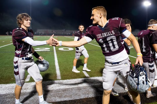 New Oxford's Brayden Long (10) and Connor Herring celebrate a 38-7 win over Bermudian Springs at South Western High School on Friday, August 23, 2019.