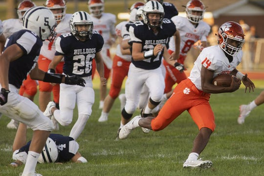 Central York's Imeire Manigault, right, runs for the Panthers' first touchdown in a 60-0 win over West York.