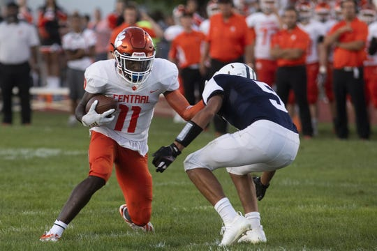 Central York's Taylor Wright-Rawls, left, takes on West York's Avery Handy. Central York defeats West York 60-0 in football at West York Area High School, Friday, August 23, 2019.