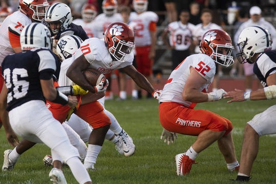 Central York's Brendan Harris, center left, runs the ball against West York. Central York defeats West York 60-0 in football at West York Area High School, Friday, August 23, 2019.