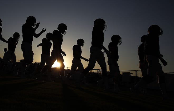 Gilbert Perry football players make their way to the locker room before a game against Phoenix Pinnacle on Aug. 23.
